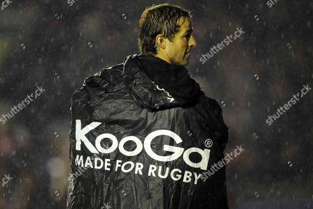 Andy Gomarsall (Harlequins) tries to stay dry under his Kooga poncho Harlequins Vs Stade Francais Paris Heineken Cup Pool 4 Twickenham Stoop Middlesex 13/12/08