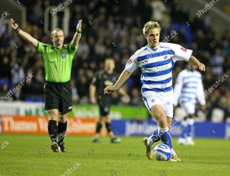 Referee Mr Kevin Wright waves play on as Kevin Doyle (Reading) sets up another attack Reading vs Coventry City at the Madejski Stadium Reading Coca-Cola Championship 01/12/2008 England London