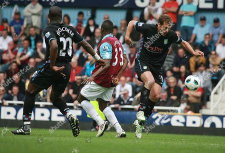 Football - Premier League - West Ham United vs Aston Villa Victor Obinna Of West Ham gets tackled Upton Park London