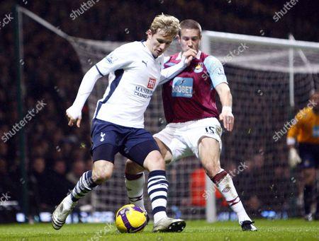 Tottenham's Russian player Roman Pavlyuchenko West Ham's Matthew Upson West Ham United Vs Tottenham Hotspur at Upton Park London Barclays Premier League 08/12/2008 England London