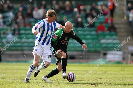 Yeovil Town's Luke Rodgers (on loan from Port Vale) receives some close attention from Brighton and Hove Albion's David Livermore Brighton and Hove Albion vs Yeovil Town at the Withdean Stadium Brighton Coca Cola Football League One 14/03/2009 England London