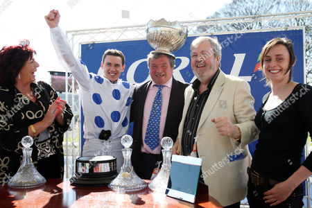 Scottish Grand National Ayr Race Course Winning jockey Paddy Brennan (white with blue spots) also to his left trainer N A Twiston-Davies and owner Seamus Murphy 18/04/2009