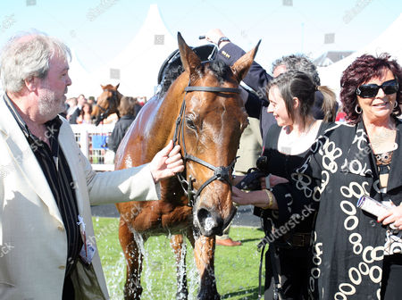 Scottish Grand National Ayr Race Course Winner 'Hello Bud' and owner Seamus Murphy 18/04/2009