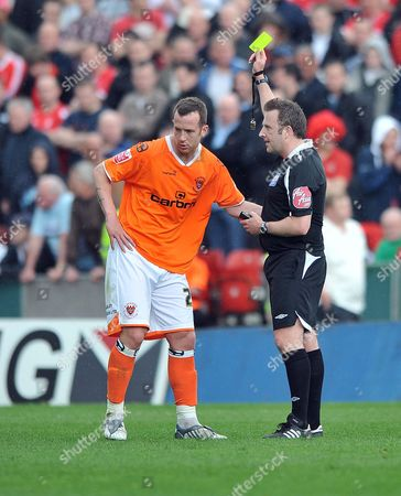 Blackpool's Charlie Adam (on loan from Rangers) is booked by referee J Moss Blackpool vs Nottingham Forest Coca Cola Championship Bloomfield Road Blackpool UK 25/04/2009