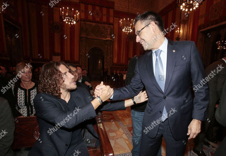 Carlos Puyol and Josep Maria Bartomeu attend the Golden Medal of Merit for Johan Cruyff Event