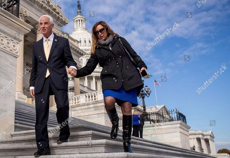 Charlie Crist, Carole Crist Rep.-elect Charlie Crist, D-Fla., left, and his wife Carole depart after newly-elected House members gathered for a freshman class photo on the Capitol steps, in Washington
