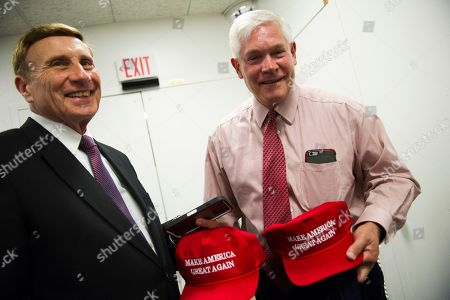 "Rep. John Mica, R-Fla., left, and Rep. Pete Sessions, R-Texas, display their ""Make America Great Again"" hats after attending a House Republican leadership meeting on Capitol Hill in Washington"