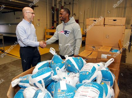 Dion Lewis, Andrew Schiff As part of Stop & Shop's commitment to provide more than 300,000 holiday meals to families throughout New England this Thanksgiving, New England Patriots running back Dion Lewis, right, joins Stop & Shop to donate 1,000 turkeys to the Rhode Island Community Food Bank, accepted by CEO Andrew Schiff, left,, in Providence, R.I