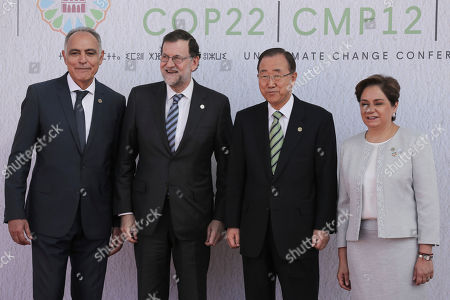 """From left, Morocco's Foreign Minister Salaheddine Mezouar, Spain's Prime Minister Mariano Rajoy, United Nations Secretary-General Ban Ki-moon, and U.N. climate chief Patricia Espinosa of Mexico pose prior to the opening session of the high level segment of the U.N. climate conference in Marrakech, Morocco, . United Nations Secretary-General Ban Ki-moon says he hopes Donald Trump will shift course on global warming and """"understand the seriousness and urgency"""" of addressing the problem"""