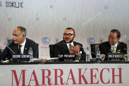 """From left, Morocco's Foreign Minister Salaheddine Mezouar, Morocco's King Mohammed VI and United Nations Secretary-General Ban Ki-moon attend the opening session of the U.N. climate conference in Marrakech, Morocco, . Ki-moon says he hopes Donald Trump will shift course on global warming and """"understand the seriousness and urgency"""" of addressing the problem"""