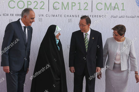 """From left, Morocco's Foreign Minister Salaheddine Mezouar, Iran's Vice President Masoumeh Ebtekar, United Nations Secretary-General Ban Ki-moon, and U.N. climate chief Patricia Espinosa of Mexico pose prior to the opening session of the U.N. climate conference in Marrakech, Morocco, . French President Francois Hollande on Tuesday urged the United States to respect the """"irreversible"""" Paris Agreement on climate change, and said France will lead a dialogue on the topic with President-elect Donald Trump """"on behalf of the 100 countries that have ratified"""" the deal"""