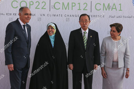 """From left, Morocco's Foreign Minister Salaheddine Mezouar, Iran's Vice President Masoumeh Ebtekar, United Nations Secretary-General Ban Ki-moon, and U.N. climate chief Patricia Espinosa of Mexico pose prior to the opening session of the high level segment of the U.N. climate conference in Marrakech, Morocco, . Ki-moon says he hopes Donald Trump will shift course on global warming and """"understand the seriousness and urgency"""" of addressing the problem"""