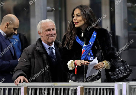 Stock Photo of Italian coach legend Giovanni Trapattoni walks with Spanish actress Laura Barriales on the tribune prior an international friendly soccer match between Italy and Germany, at the San Siro stadium in Milan, Italy