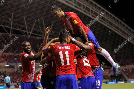 Costa Rica's Christian Bolanos is congratulated by teammates after scoring against United States during a 2018 World Cup qualifying soccer match in San Jose, Costa Rica, . Costa Rica won the game 4-0