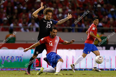 Stock Picture of Costa Rica's Randall Azofeifa, 14, is challenged by United States' Fabian Johnson during a 2018 World Cup qualifying soccer match in San Jose, Costa Rica, . Costa Rica won the match 4-0