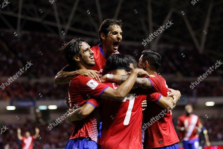 Costa Rica's Christian Bolanos is congratulated by teammates after scoring against United States during a 2018 World Cup qualifying soccer match in San Jose, Costa Rica