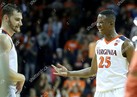 Virginia forward Mamadi Diakite (25) and forward Austin Nichols (1) laugh during the second half of an NCAA college basketball game on in Charlottesville, Va. Virginia defeated St. Francis (N.Y.) 72-32