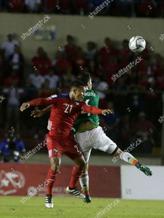 Stock Photo of Panama's Amilcar Enriquez, left heads the ball with Mexico's Rafa Marquez during a 2018 World Cup qualifying soccer match in Panama CIty