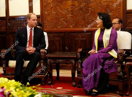 William, Dang Thi Ngoc Thinh Britain's Prince William, left, listens to Vietnamese Vice President Dang Thi Ngoc Thinh in Hanoi, Vietnam,. Prince William is on the first visit to Vietnam where he will attend an international conference in the fight to protect elephants, rhinos and other endangered species