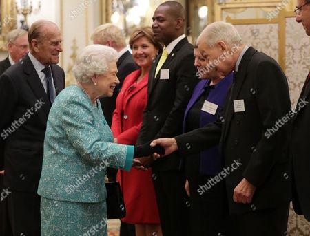 Queen Elizabeth II greets Frank Field MP (the co-founder of Cool Earth charity that works alongside indigenous villages to halt rainforest destruction)