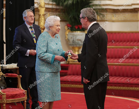 The High Commissioner for Australia, His Excellency the Hon. Alexander Downer, is presented with a certificate by Queen Elizabeth II