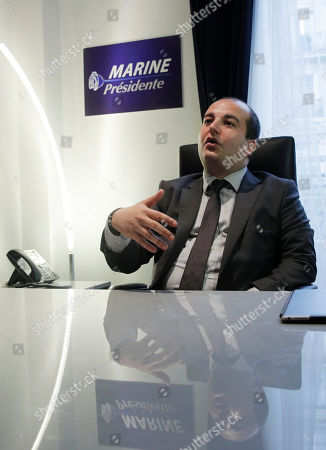 David Rachline, campaign director for far-right leader Marine le Pen gestures during the inauguration of her presidential campaign headquarters, Wednesday, Nov.16, 2016 in Paris. Le Pen is convinced that her anti-immigration, anti-Islam views can lead her to the presidency in five months
