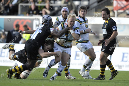 Serge Betsen of London Wasps tackles Shane Geraghty of Northampton Saints Guinness Premiership Round 5 London Wasps vs Northampton Saints played at Adams Park 04/10/2009 London