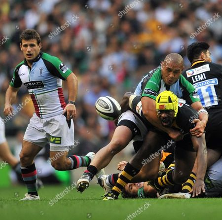 Tani Fuga of Harlequins tackles Serge Betsen (c) of London Wasps Harlequins vs London Wasps Round 1 Guinness Premiership London Double Header Twickenham Stadium London England 27 8 09 England London