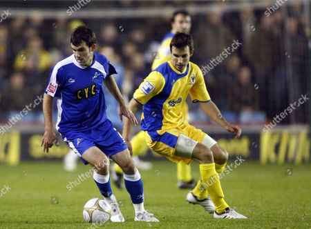 Football Danny Schofield of Millwall holds of Steven Gregory of AFC Wimbledon FA Cup First Round Millwall Vs AFC Wimbledon at The New Den Stadium 09/11/2009