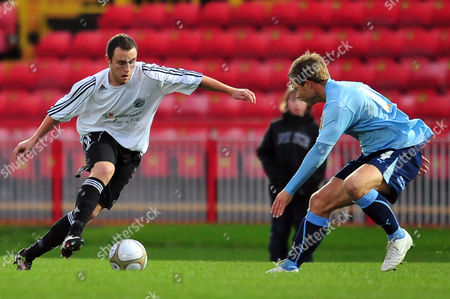 Football FA Cup Round one Gateshead vs Brentford at the Gateshead International Stadium Peter Winn (Gateshead) looks to go past Danny Foster (Brentford) 07/11/2009