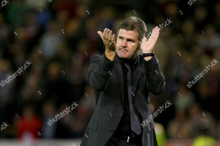 Football - Carling Cup Round Three - Burnley vs Bolton Wanderers Manager of Burnley Brian Laws applauds the home crowd at Turf Moor