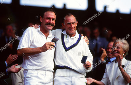 Tennis John Newcombe and Tony Roche celebrate winning the Men's Doubles in the Wimbledon Seniors (Over 35s) as the Duchess of Kent looks on Wimbledon