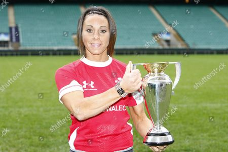 Rugby Union - Women's Rugby World Cup 2010 Media Launch Wales player Non Evans with the trophy at Twickenham Stadium