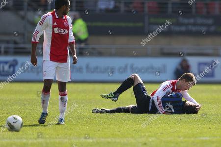 Football - NextGen Series Final - Ajax vs Inter Milan Joel Veltmanof Ajax checks if Andrea Romano of Inter is okay