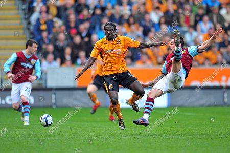 Football - Premier League - Hull City vs Burnley at the KC Stadium Bernard Mendy (Hull) and Daniel Fox (Burnley)