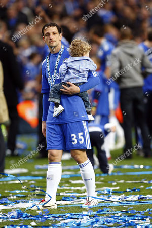Football - Premier League - Chelsea vs Wigan Athletic Chelsea's Brazilian footballer Juliano Belletti with his son at Stamford Bridge