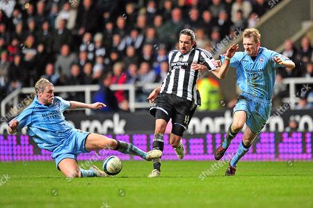 Football Coca-Cola Championship Newcastle United vs Scunthorpe United at St James' Park Grant McCann (Scunthorpe) slides in on Jonas Gutierrez (Newcastle United) also seen Andrew Wright (Scunthorpe) 17/03/2010