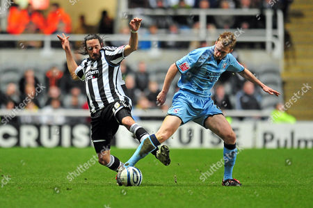Football Coca-Cola Championship Newcastle United vs Scunthorpe United at St James' Park Jonas Gutierrez (Newcastle United) lunging into Andrew Wright (Scunthorpe) 17/03/2010