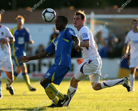 Football - FA Cup Fourth Round Qualifying - Basingstoke Town vs AFC Wimbledon Basingstoke Town's Jide Ogunbote under pressure from Steven Gregory of AFC Wimbledon at The Camrose Ground Basingstoke