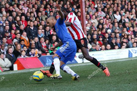 Football - 2012 / 2013 FA Cup - Fourth Round: Brentford vs Chelsea Ryan Bertrand of Chelsea and Clayton Donaldson of Brentford at Griffin Park London London, UK