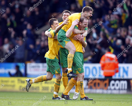 Stock Photo of Football Gary Doherty of Norwich City and Michael Nelson of Norwich City celebrates Chris Martin of Norwich City Goal Coca-Cola Footbal League One Norwich City vs Leeds United at Carrow Road 27/03/2010