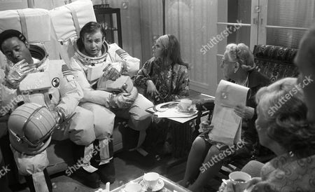 Weston Gavin (as Bill Johnson) and Lon Satton (as Lunar Module Pilot), with Madoline Thomas (as Granny), Zoe Wanamaker (as Alice) and Mary Chester (as Mother)
