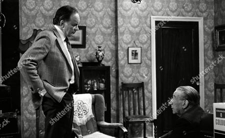 Tony Britton (as Christopher Collinson) and Wilfred Pickles (as Bernard King)