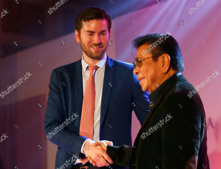 "Shawn McLain, Luis ""Chavit"" Singson Shawn McLain, Vice-president for Business Development, Miss Universe Organization, left, and Gov. Luis ""Chavit"" Singson, organizer and a major sponsor of the Miss Universe 2017 beauty pageant, shake hands during the media launch in suburban Makati city east of Manila, Philippines. Organizers say Miss Universe will be held January 30, 2017, the third time that the Philippines will be hosting"