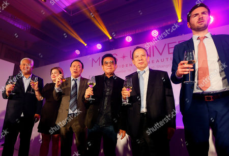 "Shawn McLain, Kazuo Okada, Luis ""Chavit"" Singson, Wilson Tieng, Ruby Anne Reyes, Ricky Alegre Organizers and sponsors of the Miss Universe 2017 beauty pageant prepare to make a toast during the media launch, in suburban Makati city east of Manila, Philippines. Organizers say Miss Universe will be held January 30, 2017, the third time that the Philippines will be hosting. With from right, Shawn McLain, Vice-president Business Development, Miss Universe Organization, Casino and Entertainment executive Kazuo Okada, and Gov. Luis ""Chavit"" Singson of Ilocos Sur province, Wilson Tieng, Ruby Anne Reyes, Vice-president for Corporate Marketing, SM Lifestyle Entertainment, and Ricky Alegre, Assistant Secretary of the Toursim Department"