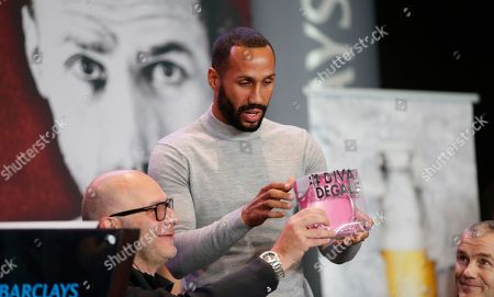 """Lou Dibella, James Degale New York based boxing promoter Lou Dibella, left, laughs as IBF Super Middleweight World Champion James Degale, of Great Britain, reacts after receiving a gift, a silver crown with the title """"Diva Regale,"""" from upcoming opponent WBC Super Middleweight World Champion Badou Jack during a news conference announcing the pair's Super Middleweight World Title Unification bout, in New York. The fight is scheduled for Jan. 14, 2017, at the Barclays Center in Brooklyn"""