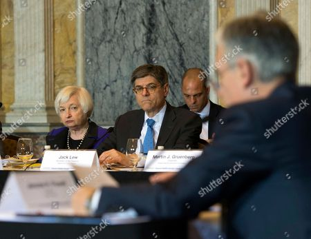 Jack Lew, Janet Yellen Secretary of the Treasury and Council Chairperson Jack Lew and Federal Reserve Chair Janet Yellen listen during the Financial Stability Oversight Council at the Treasury Department in Washington