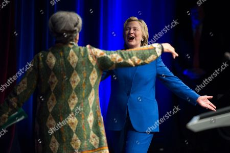 Hillary Clinton is welcomed onstage by Marian Wright Edelman, president and founder of the Children's Defense Fund, before addressing the group's Beat the Odds celebration at the Newseum in Washington