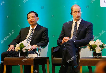 Stock Image of Prince William, Nguyen Xuan Cuong Vietnam's Minister of Agriculture Nguyen Xuan Cuong, left, and Britain's Prince William, Duke of Cambridge, right, listen to a speech at an international conference on illegal wildlife trade in Hanoi, Vietnam, . The two-day conference will discuss ways to eridicate illegal wildlife trade