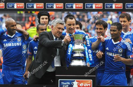 Football - Chelsea v Portsmouth FA Cup Final 15/05/2010 at Wembley Carlo Ancelotti Chelsea manager with his players and the trophy L to R Nicolas Anelka Petr Cech John Terry Juliano Belletti and Florent Malouda